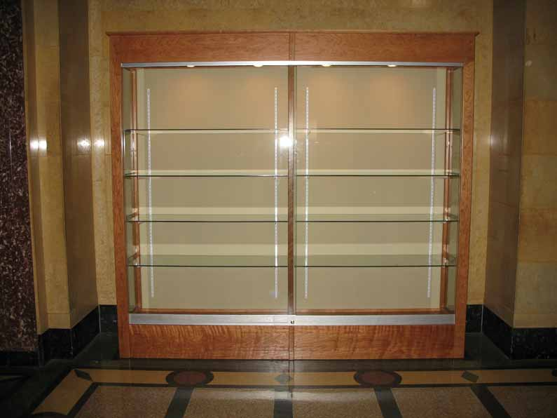 Glass Cabinet: Paper Work Stored Away
